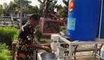 KKN-PPM UGM Gergunung, Klaten Buat Alat Cuci Tangan Sistim Penjernih Air
